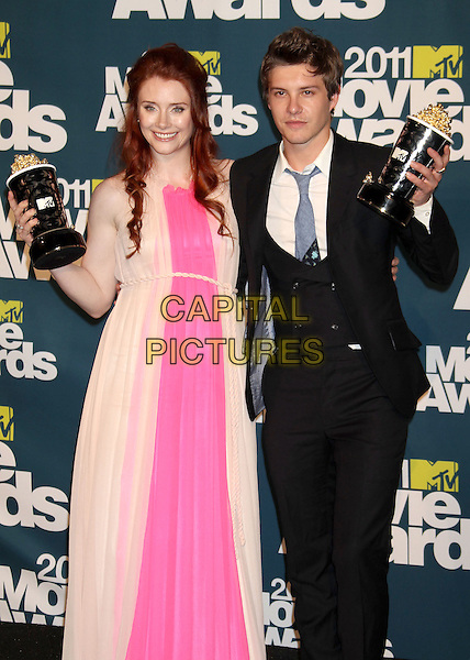 Bryce Dallas Howard and Xavier Samuel.2011 MTV Movie Awards - Press Room held at Gibson Amphitheatre, Universal City, California, USA..June 5th, 2011.pressroom half 3/4 length pink beige dress award winners blue tie suit black waistcoat award trophy winner trophies .CAP/ADM/RE.©Russ Elliot/AdMedia/Capital Pictures.