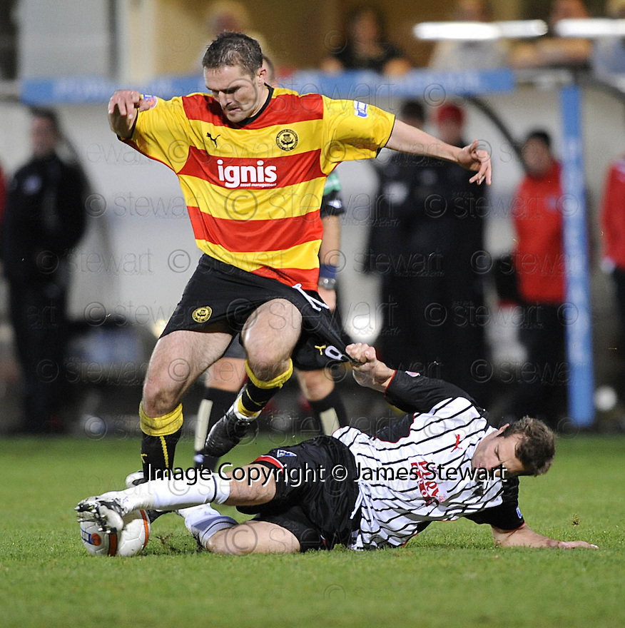 14/11/2009  Copyright  Pic : James Stewart.sct_jspa11_dunfermline_v_partick  . :: DAVID ROWSON IS CHALLENGE BY GRAEME HOLMES :: .James Stewart Photography 19 Carronlea Drive, Falkirk. FK2 8DN      Vat Reg No. 607 6932 25.Telephone      : +44 (0)1324 570291 .Mobile              : +44 (0)7721 416997.E-mail  :  jim@jspa.co.uk.If you require further information then contact Jim Stewart on any of the numbers above.........