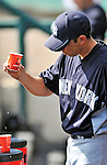 8 March 2011: New York Yankees' infielder Doug Bernier checks out a leaky cup in the dugout during a Spring Training game against the Atlanta Braves at Champion Park in Orlando, Florida. The Yankees edged out the Braves 5-4 in Grapefruit League action. Mandatory Credit: Ed Wolfstein Photo