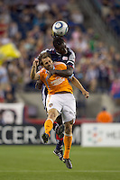 Houston Dynamo midfielder Brian Mullan (9) and New England Revolution midfielder Shalrie Joseph (21) battle for head ball. The New England Revolution defeated Houston Dynamo, 1-0, at Gillette Stadium on August 14, 2010.