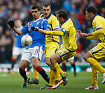 Salim Kerkat takes on the Kilmarnock defence as he ghosts past Liam Kelly, James Fowler and Lewis Toshney