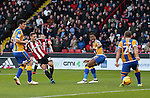 Billy Sharp of Sheffield Utd takes a shot on goal during the English League One match at the Bramall Lane Stadium, Sheffield. Picture date: November 19th, 2016. Pic Simon Bellis/Sportimage
