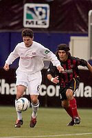 New England Revolution's Jay Heaps is chased by the MetroStars' Sergio Galvan Rey. The New England Revolution played the NY/NJ MetroStars to a 1 to 1 tie at Giant's Stadium, East Rutherford, NJ, on April 25, 2004.