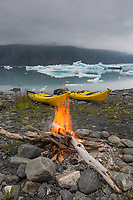Campfire on a beach in Bear Glacier Lagoon, Kenai Fjords National Park, southcentral, Alaska.