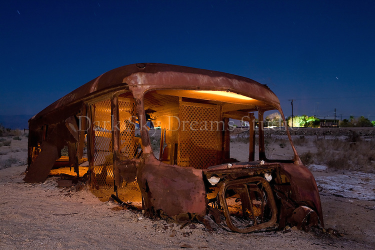 Little remains of an rusted panel van at a flooded neighborhood in Bombay Beach, California on the shore of the Salton Sea