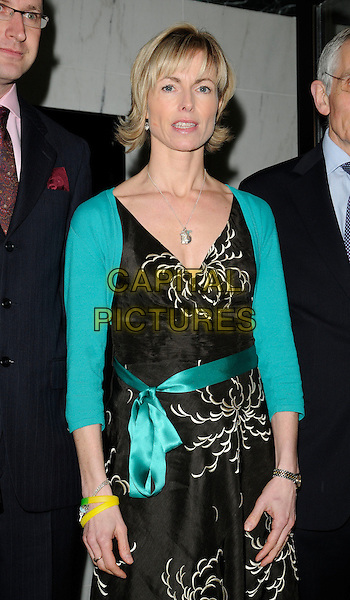 "KATE McCANN .Attending ""Still Missing, Still MIssed"" Fundraiser to mark the 1000th day since the disappearance of Madeline McCann, The Roof Gardens, Kensington High Street, London, England, UK, .January 27th 2010..half length parent mother mum mom turquoise black print dress belt sash shrug cardigan yellow bracelet wristband .CAP/CAN.©Can Nguyen/Capital Pictures."