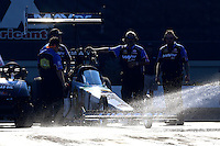 Sep 14, 2013; Charlotte, NC, USA; Crew members surround the car of NHRA top fuel dragster driver Brandon Bernstein as water is sprayed in the water box during qualifying for the Carolina Nationals at zMax Dragway. Mandatory Credit: Mark J. Rebilas-