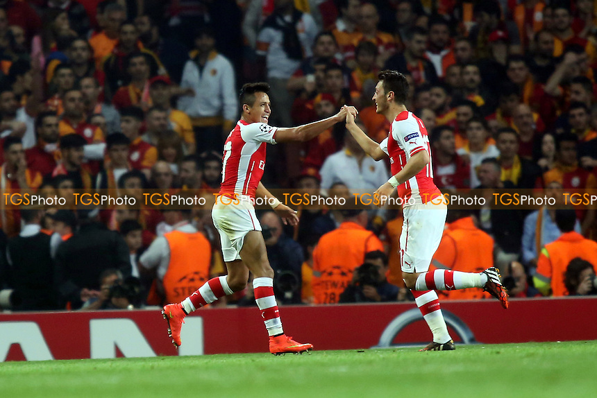 Alexis Sanchez celebrates scoring Arsenal's third goal with Mesut Ozil - Arsenal vs Galatasaray - UEFA Champions League Football at the Emrates Stadium, London - 01/10/14 - MANDATORY CREDIT: Paul Dennis/TGSPHOTO - Self billing applies where appropriate - contact@tgsphoto.co.uk - NO UNPAID USE