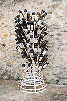 A white painted iron stand to dry bottles with bottles standing upside down, the same style of stand was used by Marcel Duchamp as a work of art at an exhibition. Chateau Vannieres (Vannières) La Cadiere (Cadière) d'Azur Bandol Var Cote d'Azur France