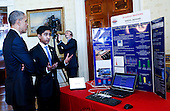 United States President Barack Obama listens to Nikhil Behari (R) from Sewickley, Pennsylvania, who created a security system that uses additional data to verify your identity during the 2015 White House Science Fair, a celebration of students winners of STEM (Science, technology, engineering and math) competitions from across the country at the White House, in Washington, DC on March 23, 2015.<br /> Credit: Aude Guerrucci / Pool via CNP