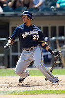 Milwaukee Brewers outfielder Carlos Gomez #27 follows through with his swing during the Major League Baseball game against the Chicago White Sox on June 24, 2012 at US Cellular Field in Chicago, Illinois. The White Sox defeated the Brewers 1-0 in 10 innings. (Andrew Woolley/Four Seam Images).