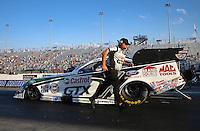 Sep 13, 2013; Charlotte, NC, USA;  Crew chief Jimmy Prock runs behind NHRA funny car driver John Force during qualifying for the Carolina Nationals at zMax Dragway. Mandatory Credit: Mark J. Rebilas-