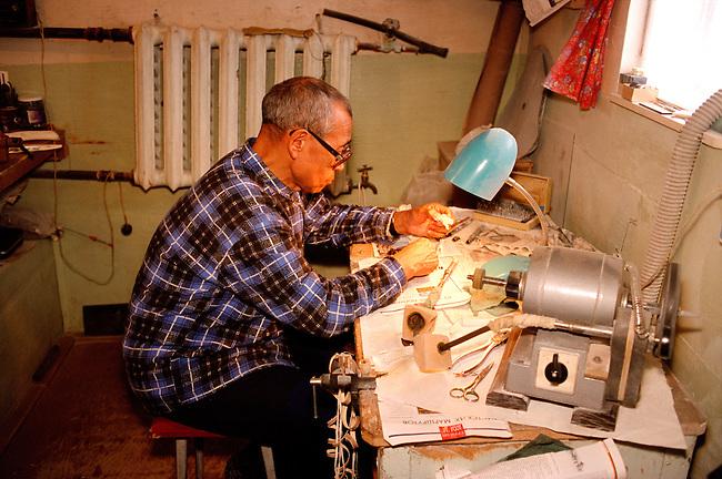 Elderly Chukchi carver, Ivan Seigutegin, in his workshop in Uelen. Chukotka, Siberia, Russia.