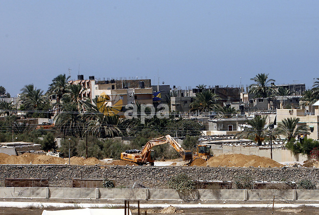 A view of soldiers from the Egyptian army destroying the infrastructure of smuggling tunnels along the Egypt-Gaza border is seen from Rafah, southern Gaza Strip, on August 22, 2012, as sources in Cairo suggested some of the gunmen from the attack on Egyptian troops in northern Sinai on August 8, that killed 16 soldiers, had entered Sinai through the tunnels. The tunnels trade, which analysts estimate is worth half a billion dollars a year, brings a wide variety of goods, including food, fuel and building materials, into the coastal territory which has been under an Israeli blockade since 2006. Photo by Eyad Al Baba