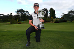Daniel Hillier poses with the trophy after winning the finals of Match Play during the New Zealand Amateur Championship, Titirangi Golf Course, Auckland, New Zealand. Sunday 19 April 2015. Photo: Simon Watts/www.bwmedia.co.nz <br /> All images &copy; NZ Golf and BWMedia.co.nz New Zealand Golf Images:<br />