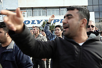 Pictured: Migrants protest Monday 06 February 2017<br /> Re: Scuffles between migrants and police broke out during a visit by Immigration Policy Minister Yiannis Mouzalas at the Elliniko migrant camp located in the former airport in the outskirts of Athens, Greece.