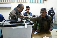 EGYPT, Cairo : Egyptians cast their vote at a polling station  in the district of Nasr City for the constitutional referendum in Cairo, Egypt, on January 15, 2014. AFP PHOTO/CIRGINIE NGUYEN HOANG