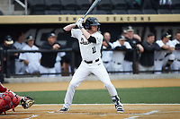 Shane Muntz (11) of the Wake Forest Demon Deacons at bat against the Sacred Heart Pioneers at David F. Couch Ballpark on February 15, 2019 in  Winston-Salem, North Carolina.  The Demon Deacons defeated the Pioneers 14-1. (Brian Westerholt/Four Seam Images)