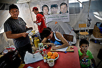 Victor Segovia´s  (48) relatives. MAritza Segovia (23) is writng a letter to his father while Victor brother is shwing me a letter they have received form Victor. Relatives and friends wait outside the mine where 33 miners are trapped in a collapsed tunnel in North Chile since August 5th.