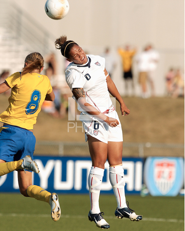 USA forward Natasha Kai, right, heads the ball with Sweden's Stina Segerstrom (8) during the second half, Saturday, July 15, 2006 in Blaine, Minn.