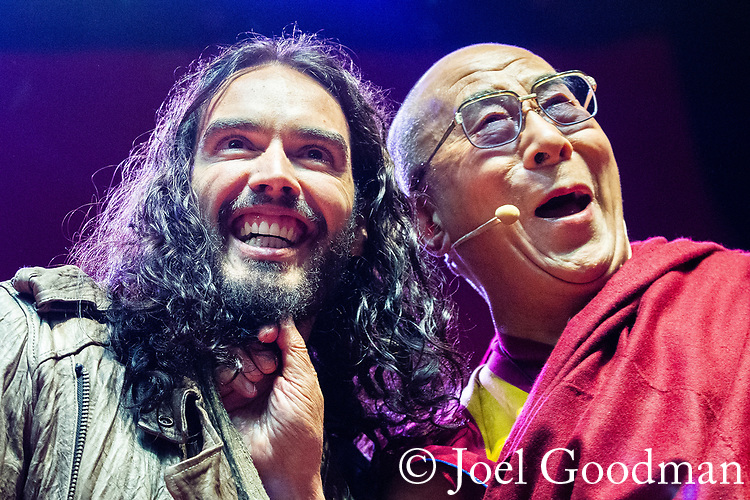 © Joel Goodman - 07973 332324 . 16/06/2012 . Manchester , UK . RUSSELL BRAND and the DALAI LAMA , tugging Brand's beard , at the Stand Up and Be the Change youth event , hosted by the Dalai Lama during a 10 day UK tour , at the Manchester Arena . Photo credit : Joel Goodman