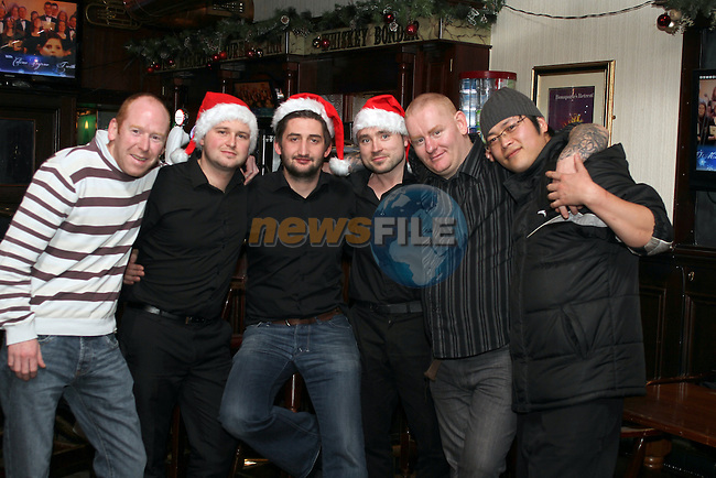 Eddie Lynch, Dean, Marco, Ciaran, Raymond and Paul on Christmas Eve in the Laurence Inn. ..(Photo credit should read Jenny Matthews www.newsfile.ie)....This Picture has been sent you under the conditions enclosed by:.Newsfile Ltd..The Studio,.Millmount Abbey,.Drogheda,.Co Meath..Ireland..Tel: +353(0)41-9871240.Fax: +353(0)41-9871260.GSM: +353(0)86-2500958.email: pictures@newsfile.ie.www.newsfile.ie.