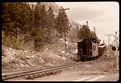 Caboose &amp; gondolas with rock on Monarch switchback.<br /> D&amp;RGW  Monarch Switchback, CO