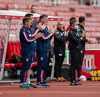 4th July 2020; Bet365 Stadium, Stoke, Staffordshire, England; English Championship Football, Stoke City versus Barnsley; The Stoke bench applaud for the NHS