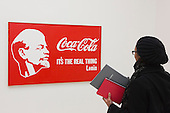 London, UK. 25 November 2014. Lenin and Coca-Cola, 1982, by Alexander Kosolapov. Press preview of the new exhibition Post Pop: East Meets West at the Saatchi Gallery, London. The Tsukanov Family Foundation and Saatchi Gallery present the first comprehensive exhibition examining why Pop Art has had such a powerful influence over artists from world regions that had or still have very different and sometimes opposing ideologies. The exhibition brings together 250 works by 110 renowned artists from China, the Former Soviet Union, Taiwan, the UK and USA in the largest survey to date exploring Pop Art's enduring legacy. The exhibition is open to the public from 26 November 2014 to 23 February 2015, admission is free. Photo: Bettina Strenske