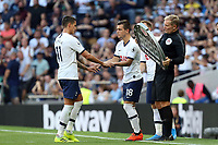 Giovani Lo Celso of Tottenham Hotspur replaces Erik Lamela of Tottenham Hotspur during Tottenham Hotspur vs Newcastle United, Premier League Football at Tottenham Hotspur Stadium on 25th August 2019