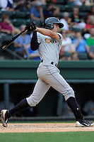 Center fielder Brandon Thomas (32) of the Charleston RiverDogs in a game against the Greenville Drive on Wednesday, June 11, 2014, at Fluor Field at the West End in Greenville, South Carolina. Greenville won, 6-3. (Tom Priddy/Four Seam Images)