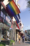 Rainbow and State Flags hanging over sidewalk stores, Castro District, San Francisco, California
