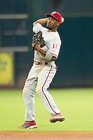 Philadelphia Phillies shortstop Jimmy Rollins #11 throws to first during the Major League baseball game against the Houston Astros on September 16th, 2012 at Minute Maid Park in Houston, Texas. The Astros defeated the Phillies 7-6. (Andrew Woolley/Four Seam Images).