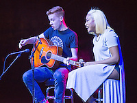 Rachel West '15, with Reilly Brown '17 on guitar, performs during Springfest, April 4, 2015 at the Remsen Bird Hillside Theater.<br /> (Photo by Marc Campos, Occidental College Photographer)