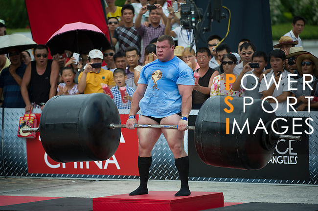 HAINAN ISLAND, CHINA - AUGUST 24:  Vytautas Lalas of Lithuania competes at the Deadlift for Max event during the World's Strongest Man competition at Yalong Bay Cultural Square on August 24, 2013 in Hainan Island, China.  Photo by Victor Fraile