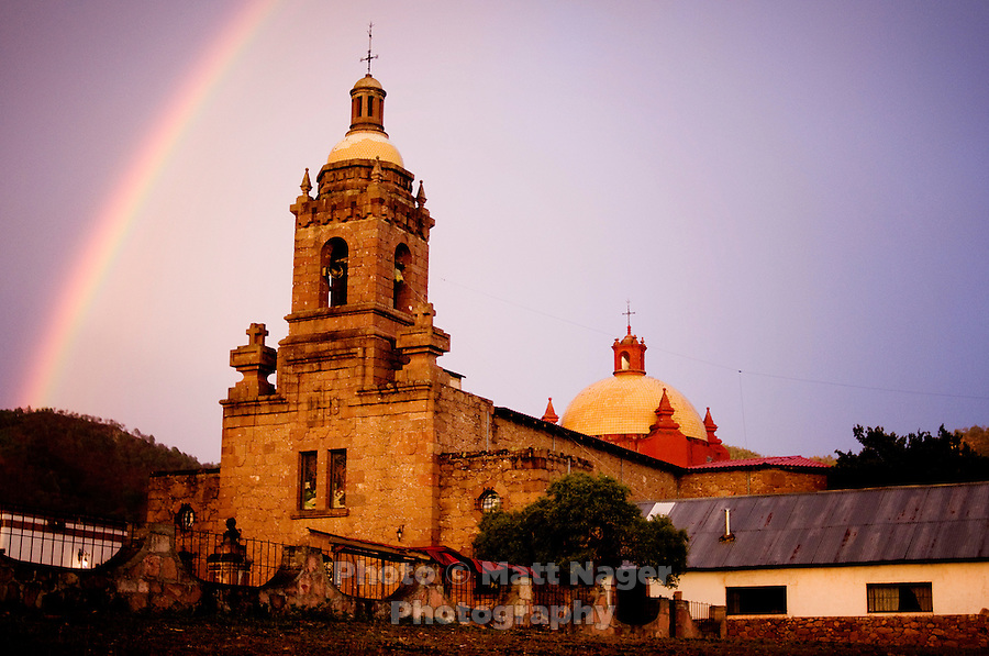 A rainbow sits over the San Francisco Javier de Cerocahui church in the small village of Cerocahui, about 8 miles from the Bahuichivo train station, Thursday, June 19, 2008. Carocahui, located at the edge of Urique Canyon, is nestled in mountains filled with roaming apple orchards and small streams and was developed as a main stopping point for Jesuit priests in the 1600s...PHOTOS/ MATT NAGER