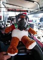 Apr 14, 2019; Baytown, TX, USA; A gas mask on a stuffed animal in the pit area of NHRA top fuel driver Steve Torrence during the Springnationals at Houston Raceway Park. Mandatory Credit: Mark J. Rebilas-USA TODAY Sports