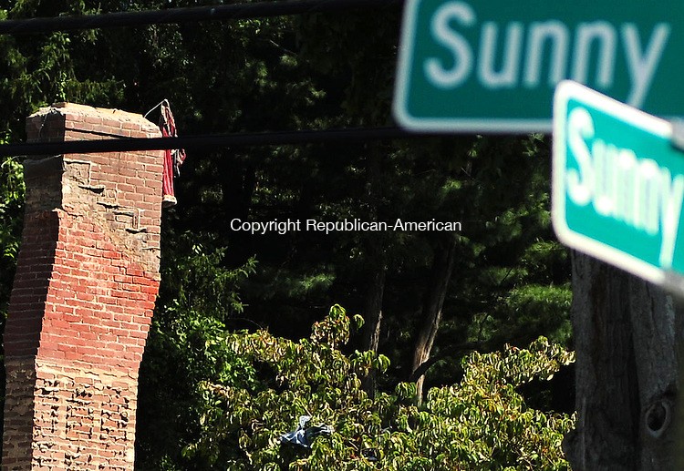 NEW MILFORD, CT 30 AUG 12 - 30_NEW083012AJ03 - A pair of red pants hangs from the chimney of 109 Sunny Valley Road in New Milford. It is all that remains at the site where the home exploded Wednesday. Alec Johnson/ Republican-American.