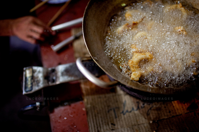 Dao Van Dan, 38, owner of the Orchid Restaurant, cooks calamari for tourists on Con Son Island, part of the Con Dao Islands.The 16 mountainous islands and islets are situated about 143 miles southeast of Ho Chi Minh City in Vietnam, in the South China. Photo taken Thursday, May 6, 2010...Kevin German / LUCEO For the New York Times