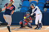 13 February 2010:  FIU's Jessy Alfonso (8) bats as the FIU Golden Panthers defeated the University of Illinois (Chicago) Flames, 2-1, at the University Park Stadium in Miami, Florida.