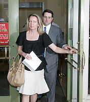 Liz Securro, left, with husband Michael Seccurro, right, exit the Charlottesville Circuit Court after William Beebe was sentenced to 18 months in prison and 500 hours of community service Thursday, March 15, 2006 in Charlottesville, VA. Seccurro accused Beebe of assaulting her during a party at U.Va.'s Phi Kappa Psi fraternity house 22 years ago. Photo/Andrew Shurtleff
