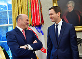 Outgoing White House Chief Economic Adviser Gary Cohn (L) talks to White House Advisor Jared Kushner, President Donald Trump's son in-law, as they attend a meeting with President Donald Trump and Crown Prince Mohammed bin Salman of the Kingdom of Saudi Arabia in the Oval Office at the White House on March 20, 2018 in Washington, D.C. <br /> Credit: Kevin Dietsch / Pool via CNP