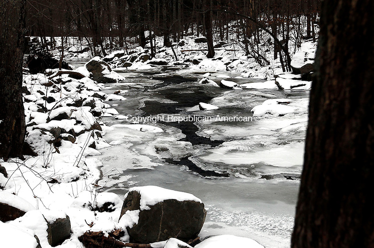 Middlebury, CT- 25 January 2014-012514CM20-  COUNTRY LIFE BANNERS---- Water flows through ice down a river at Hop Brook in Middlebury on Saturday.   Christopher Massa Republican-American
