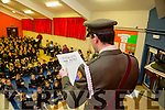 Irish defence forces Member Commandant Peadar o Cathain, reads out the 1916 proclamation to students of Gaelscoil Mhic Easmainn  on Tuesday