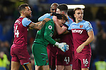 West Ham United goalkeeper David Martin celebrates with Mark Noble of West Ham United and Declan Rice of West Ham United at the end of the Premier League match at Stamford Bridge, London. Picture date: 30th November 2019. Picture credit should read: Robin Parker/Sportimage