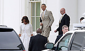 United States President Barack Obama leaves the White House with his wife Michelle Obama to attend a church service April 20, 2014 in Washington, DC. <br /> Credit: Olivier Douliery / Pool via CNP