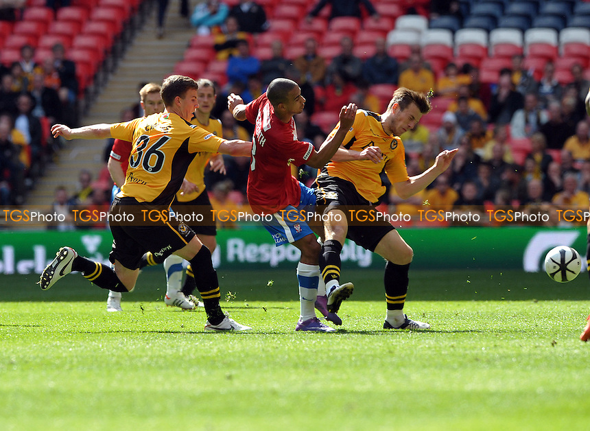 James Meredith of York City is brought down by Max Porter of Newport County - York City v's Newport County - FA Carlsberg Trophy Final at Wembley Stadium, London - 12/05/2012 - MANDATORY CREDIT: Martin Dalton/TGSPHOTO - Self billing applies where appropriate - 0845 094 6026 - contact@tgsphoto.co.uk - NO UNPAID USE.