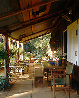 Directors chairs and wooden loungers suggest that many a hot, lazy afternoon is spent in the shade of the terrace
