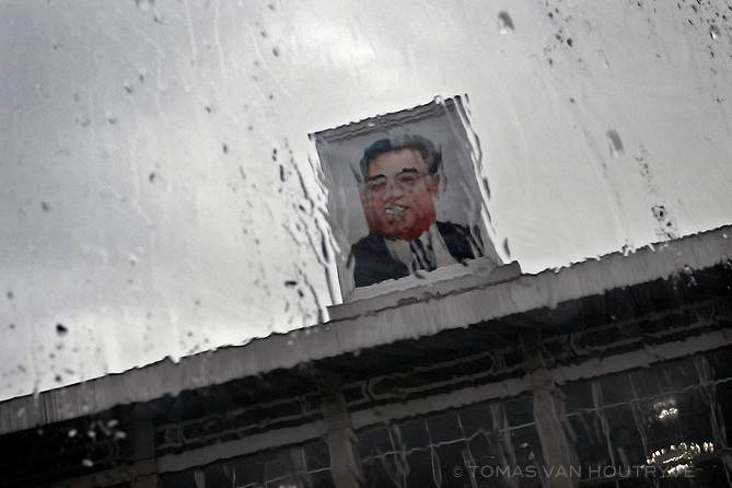 "A picture of the late leader of North Korea, Kim Il-Sung, is seen through a rain covered window in Pyongyang, North Korea (DPRK) on 25 August, 2007. After his death, he was designated in the constitution as the country's ""Eternal President"" though North Koreans generally refer to him as the ""Great Leader."""