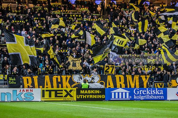 Solna 2013-10-21 Fotboll Allsvenskan AIK - IFK Norrk&ouml;ping :  <br /> AIK supporter Black Army med flaggor innan matchen mellan AIK och IFK Norrk&ouml;ping<br /> (Foto: Kenta J&ouml;nsson) Nyckelord:  supporter fans publik supporters Grekiska kolgrillsbaren